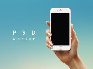 holding iphone mockup free